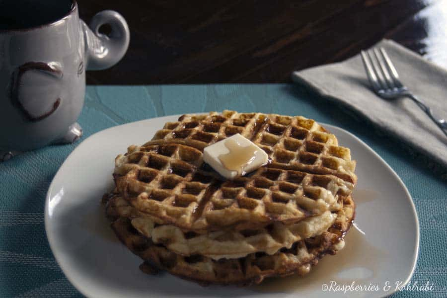 3 crispy waffles on a white plate