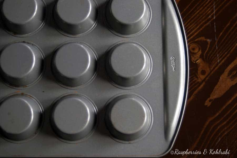 Two muffin pans stacked on top of each other