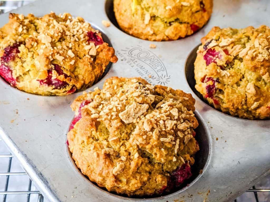 cranberry orange oatmeal muffins in a muffin pan