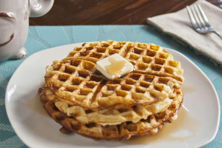 3 crispy waffles on a white plate