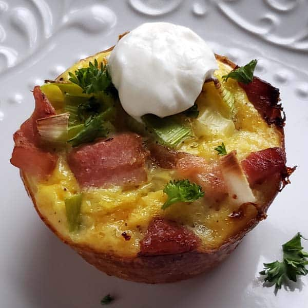 Ham Leek and Hashbrown Breakfast Cup on white plate