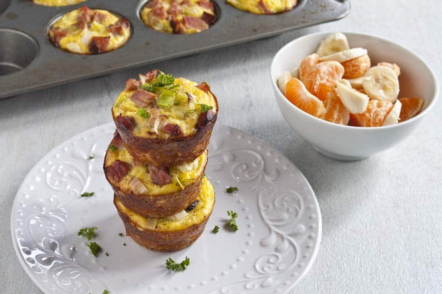 Three Ham Leek and Hashbrown Breakfast Cups on white plate