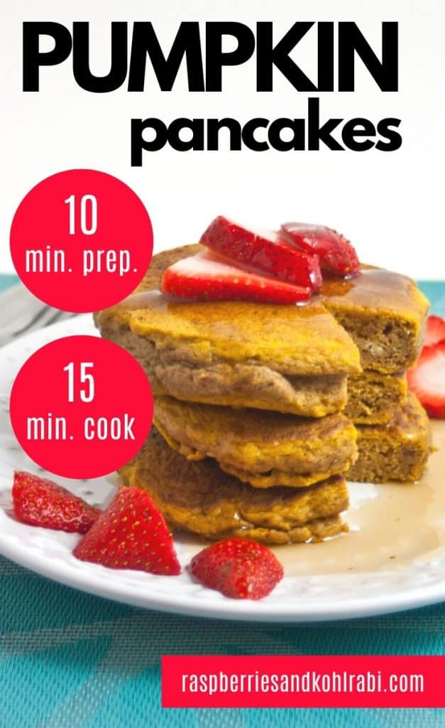 3 Pumpkin pancakes on a white plate topped with strawberries