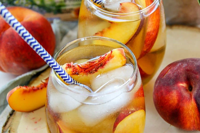 peach tumeric iced tea in clear glass