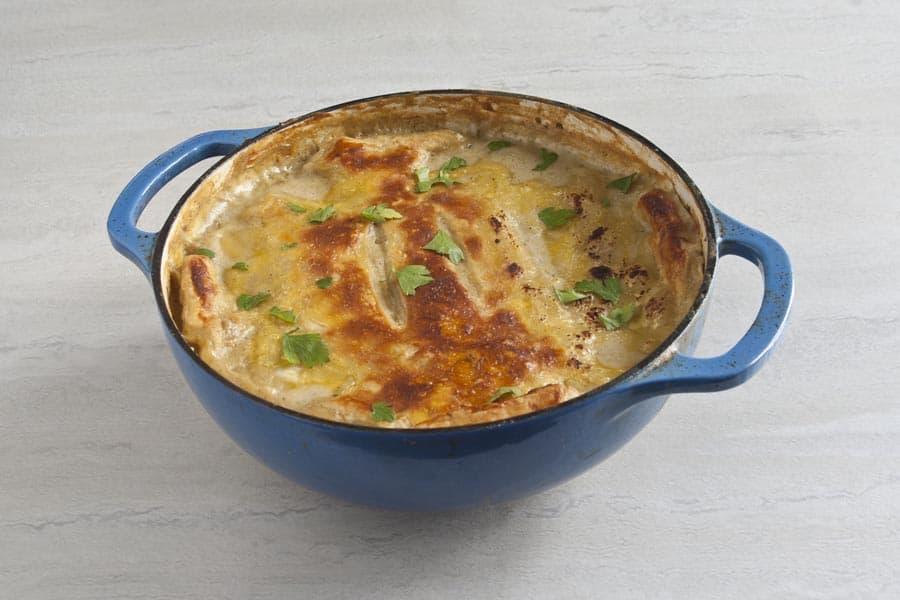 ham and leek pot pie in a blue dutch oven