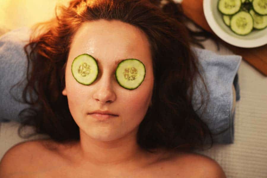 woman with cucumbers over her eyes