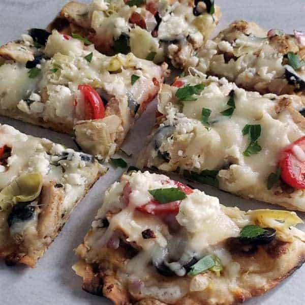 Close up of greek chicken flatbread pizza