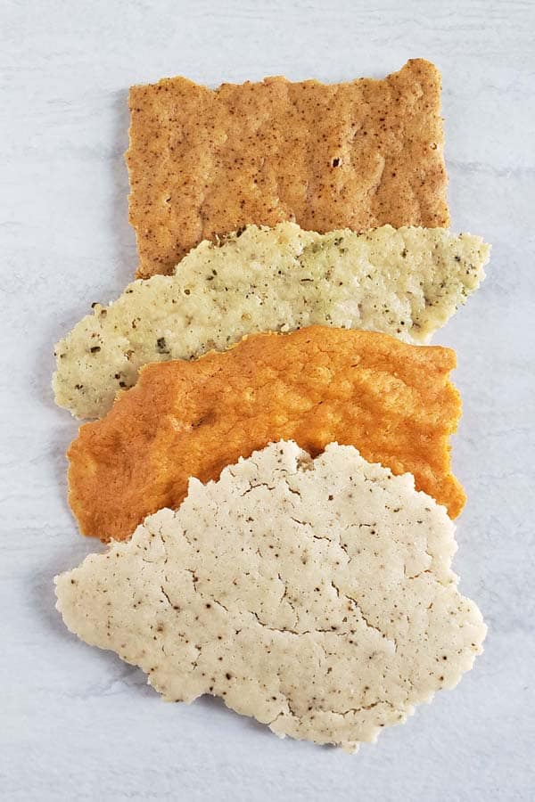 A variety of flavored sourdough crackers on a white background