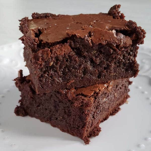 close up of two brownies stacked