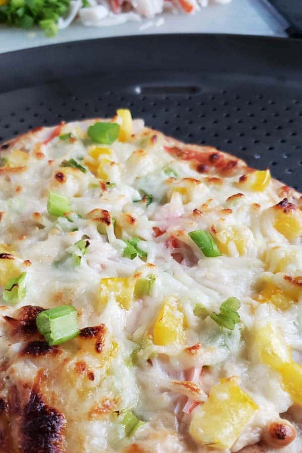 crab rangoon pizza on a metal pizza pan