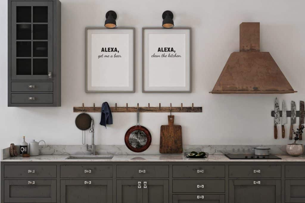 kitchen scene with two pieces of printable art hanging on the wall