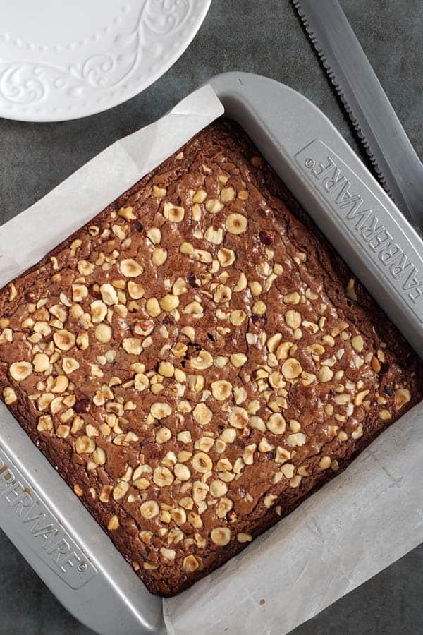 baked hazelnut brownies in metal pan